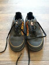 Boys black and orange carbrini astro turf trainers size 12