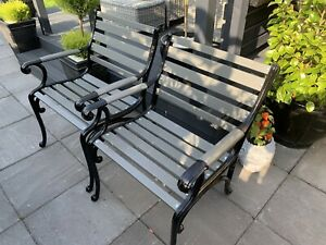 TWO CAST IRON GARDEN CHAIRS IN BLACK & GREY. NEWLY REFURBISHED