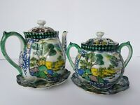Unsigned oriental teapot and sugar bowl with underplates