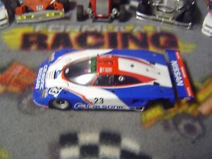 1/32 Slot.it #23 CALSON NISSAN R89C body with chassis but without motor pod-used