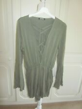VGC MISSGUIDED KHAKI STRETCHY SHOW LACE PLUNGE T SHIRT MATERIAL PLAYSUIT SIZE 12