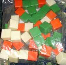 Lot of orange white and green squares cubes counting or decorating blocks pawns