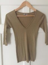 Gold ladies Michael Stars top.Very flattering. One size fits all