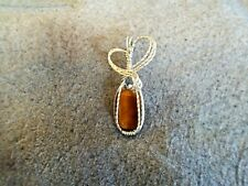 HANDCRAFTED TIGER'S EYE GEMSTONE PENDANT WRAPPED IN STERLING SILVER WIRE