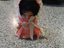 Vintage 1965 Pee Wee Doll U. D. Co. Black hair Pink dress and bonnet white shoes