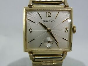 SERVICED 1960   BULOVA  *FRANKLIN*...EMERALD AND DIAMOND and 14K GOLD INSERT