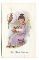 The Music Lesson, girl, parrot - c1920's Wee Japan postcard by A M Davis