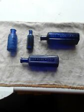 A Group Of 4 Old Blue Poison Bottles.