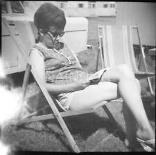 3 photo negatives - Young Lady Sunbathing - various  locations - one by caravan.