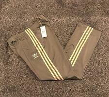 Adidas Originals Firebird Chándal Pantalones para hombre medio Kahki con rayas oro