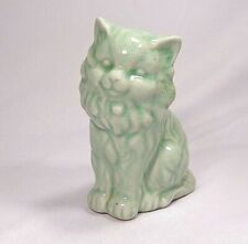 Celadon-colored Persian cat figurine