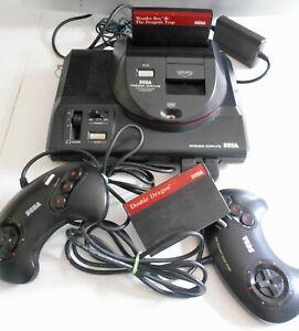 Sega Megadrive + Master system adapter+ 2 jeux - 2 Manettes + Cables