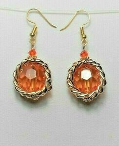 Dangle earrings - Orange acrylic round drops, gold trim, 47mm long