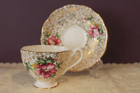 QUEEN ANNE TEACUP AND SAUCER FLORAL DESIGN ON GOLD CHINTZ