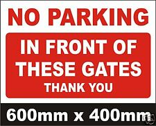 NO PARKING IN FRONT OF THESE GATES SIGN - VERY LARGE