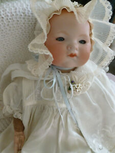 Pretty Bisque headed doll with soft body.