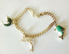 Vintage Sterling Silver Charm Braclet with Three Sterling Dolphin Charms Italy