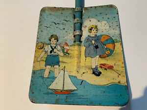 Vintage Tin Sand Pail Shovel boy and girl on beach