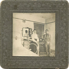 COUPLE POSING IN BEDROOM WITH MIRROR REFLECTION & ANTIQUE OCCUPATIONAL PHOTO