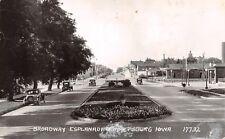Emmetsburg IA~Broadway Esplanade~RR Crossing~Depot~Glass Gas Pumps~1947 RPPC