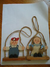 Set of 2 Wooden Swinging Boy & Girl Wall Hanging