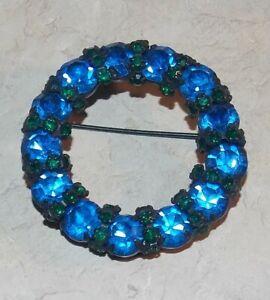 Vintage WARNER Deep Sapphire Blue Glass Rhinestone Wreath Circle Black Brooch