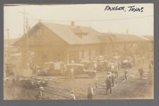 Real Photo Postcard Depot in Ranger, Texas with Cars and People Around