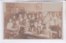 RARE VINTAGE POSTCARD CHILDREN IN SCHOOL CLASS ROOM AT THEIR DESKS