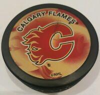 CALGARY FLAMES INGLASCO HOCKEY PUCK NHL MADE IN SLOVAKIA SKUFFED FRONT LOGO!!