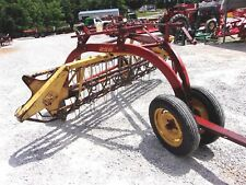 New Holland 256 Hay Rake with dolly wheels  CAN SHIP @ $1.85 per loaded mile