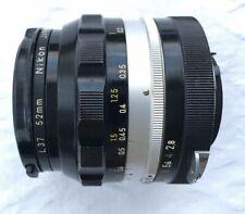 Nikon Nikkor NC Auto 24mm f/2.8 Wide Angle MF lens + Nikon 52mm L37 (UV) Lens