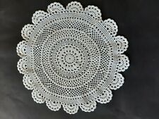 Vintage off-white round crocheted doily.
