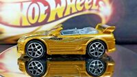 Hot Wheels  Mitsubishi Eclipse Convertible 2004 Racing Gold Color Black Stripes