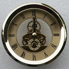 Skeleton Clock 103mm diameter quartz insertion, brass finish.