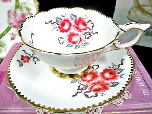 ROYAL STAFFORD tea cup and saucer pink roses painted ribbon cameo rose teacup