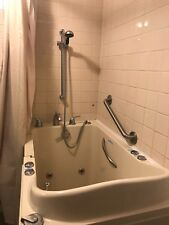 safe step walk in tub. Bought in 2011. Tan coloring. All paperwork included.....
