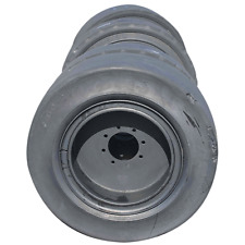(Set of 4) 12-16.5 TIRE (33x12-20) 4-USED Solid Tire and Wheels  CAT Skidsteer