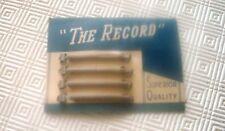 Carte de 4 barrettes métal des années 40 / 50, marque The Record