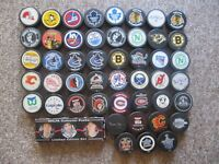 NHL Game Puck Collection. 52 Pucks with Bobby Orr, 1996 Stanley Cup + more.