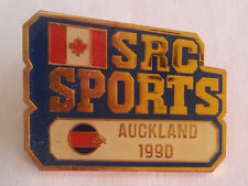 Pin's pin AUCKLAND 1990 - SRC SPORTS - CANADA MEDIA OLYMPICS (ref CL29)