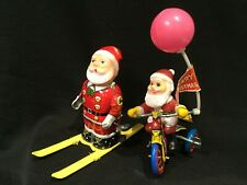 Lot of 2 Vintage 1950s Wind-up Toys - Santa on Tricycle and Skiing Santa