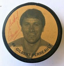 GILBERT PERREAULT # 4 Photo signed Official Canada puck. BUFFALO SABERS