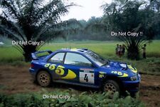 Kenneth Eriksson Subaru Impreza WRC 97 Indonesian Rally 1997 Photograph 1