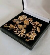 Antique 9ct Yellow gold fancy link bracelet. Suspended from are twelve charms
