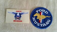 Ford Mustang patch plus Michigan sticker