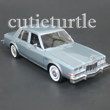 Motormax 1986 Dodge Diplomat 1:24 Diecast Model Car 74333 Light Blue