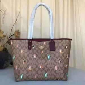 COACH REVERSIBLE CITY TOTE IN SIGNATURE CANVAS WITH PARTY ANIMALS PRINT F80246