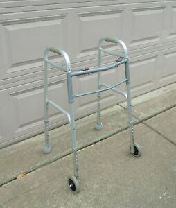 DRIVE MEDICAL DELUXE 2 BUTTON FOLDING WALKER with 5in. WHEELS