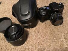 Minolta Maxxum 600si Film Camera & 35-70MM AF1:4 LENS & 50MM 1:1.7 LENS & CASES