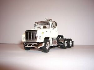 DCP FIRST GEAR 1/64 OFF WHITE FORD LOUISVILLE 9000